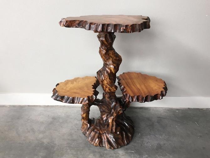 vintage mid century 3 tier carved wood table.