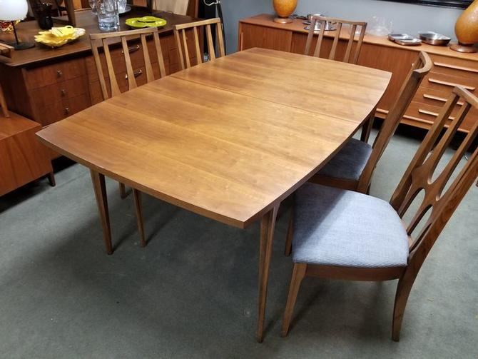 Mid-Century Modern walnut boat shape dining table from the Brasilia collection by Broyhill