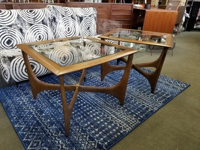 Pair of Mid-Century Modern walnut and glass side tables with Pearsall style base