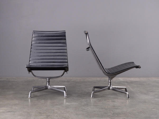 Pair of Eames Aluminum Group Lounge Chairs Black Armless Swivel by MadsenModern