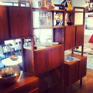 Vintage Danish shelving unit with drop-down desk and vinyl storage. Free-standing and finished on the back!