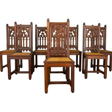 19th Century Set of 8 Country French Gothic Tiger Oak and Cane Dining Chairs by StandOutSpaces