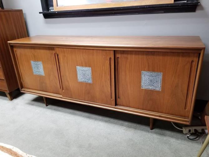 Mid-Century Modern walnut credenza with ceramic tile inserts in sliding doors