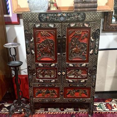 Carved & painted black lacquer cabinet