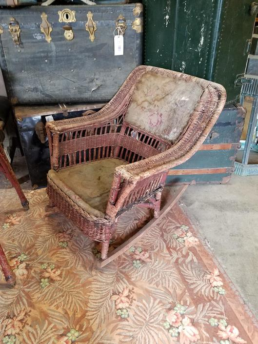 Antique wicker rocking chair as is