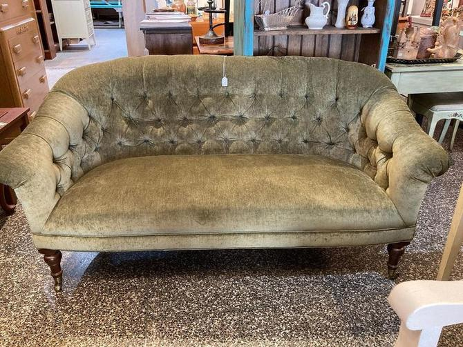 """Tufted olive green love seat.  62"""" x 34"""" x 33"""" seat height 17"""""""