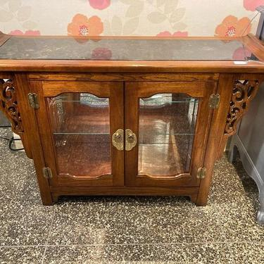 """Asian inspired, marble topped cabinet. Has a light and movable glass shelf. 45"""" x 14"""" x 28"""""""