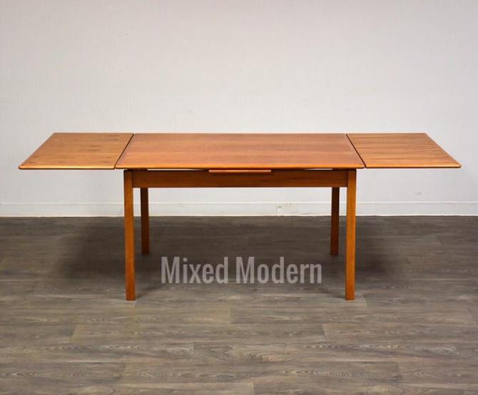 Danish Teak Draw Leaf Dining Table by mixedmodern1