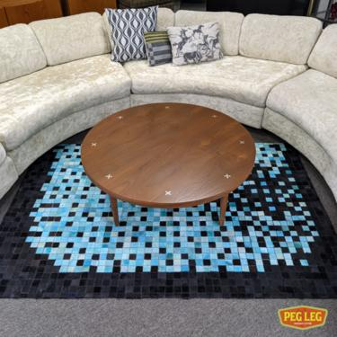 round walnut coffee table with aluminum X inlays by Merton Gershun for American of Martinsville