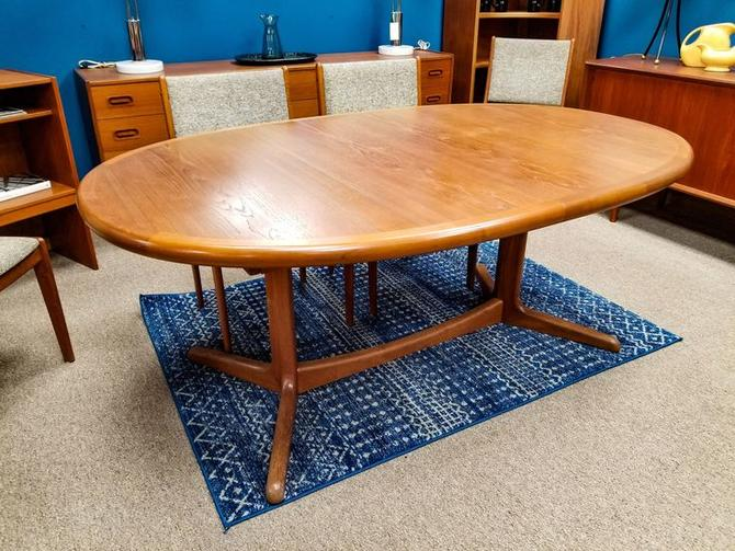 Danish Modern oval teak dining table with one extension
