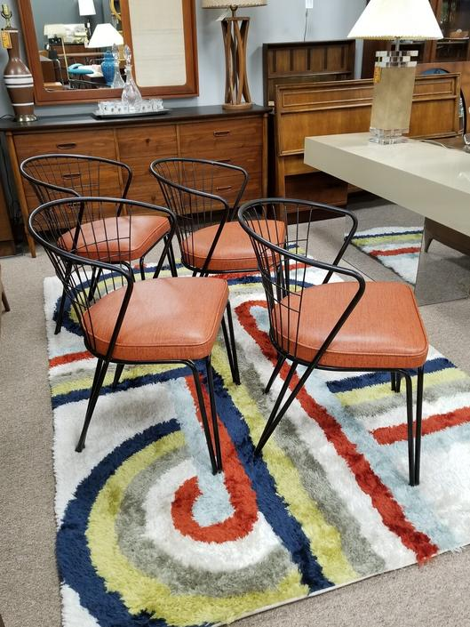 Set of four Mid-Century Modern metal frame dining chairs with curved backs