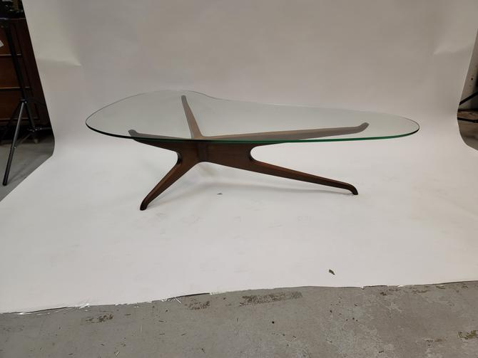 Kagan style trisymetric glass top coffee table