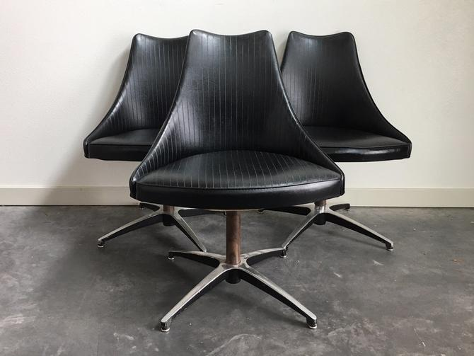3 vintage mid century modern swivel dining chairs by Virtue Furniture.