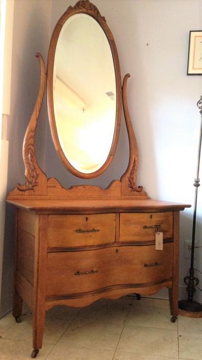 Oak dresser with tall oval mirror - $165