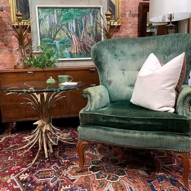 Green velvet chair with sheaf of wheat, gilt metal glass-top side table