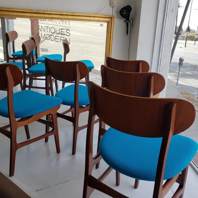 Eight Teak Chairs With Aqua Blue Seats