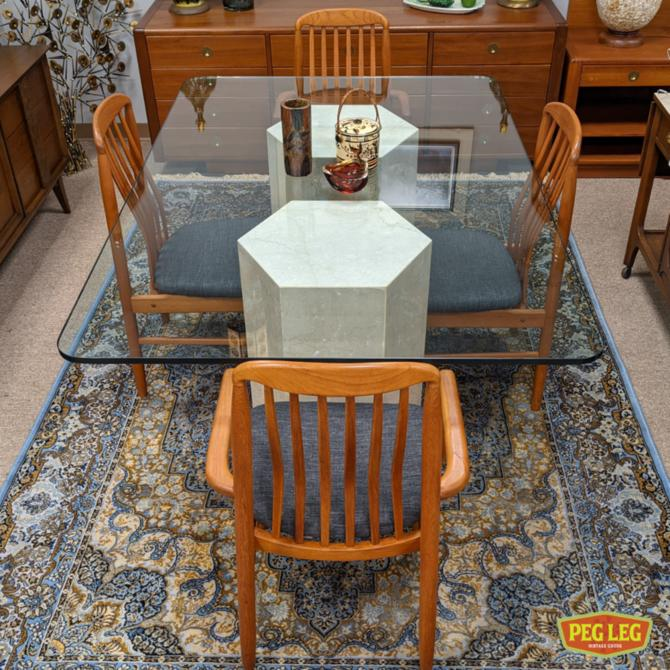 Vintage rectangular glass-top dining table with stone pedestals