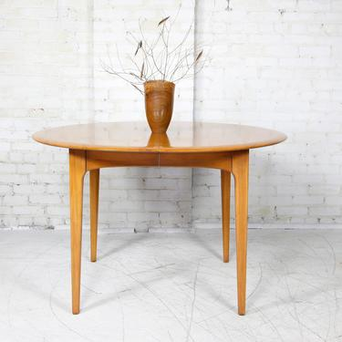 Vintage mcm solid pecan round dining table w extension leaf by Unique Furniture Makers | Free delivery in NYC and Hudson Valley areas by OmasaProjects