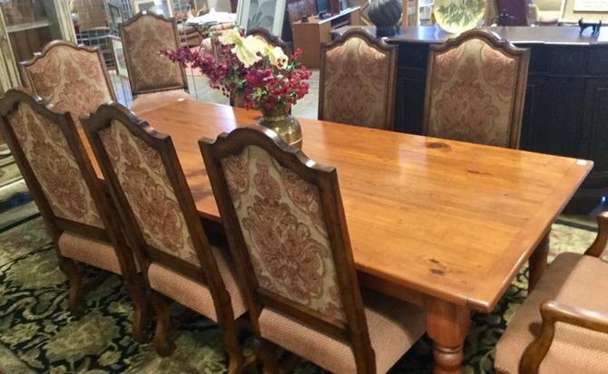 Solid wood table with 8 decorative dining chairs available at Habitat for Humanity Restore Rockville for $1995.00