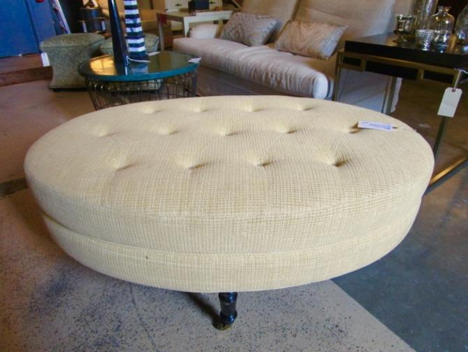BUNGALOW OVAL TUFTED OTTOMAN ON CASTERS