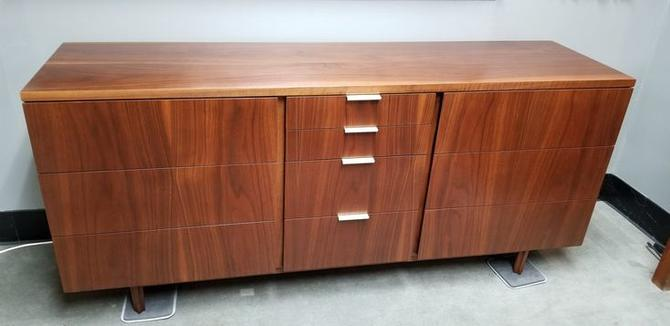 Mid-Century Modern walnut nine drawer dresser by John Stuart