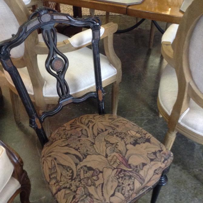 Petite ebony antique chair