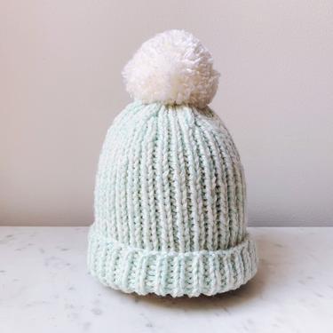 Little Minnows Hand Knit Baby Beanie Hat // Aqua Marl with White Pompom by mammothandminnow