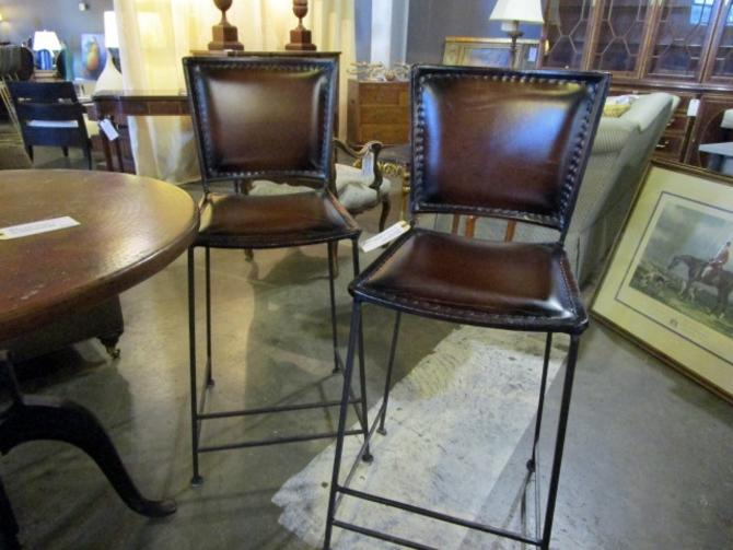 PAIR OF LEATHER AND WROUGHT IRON COUNTER STOOLS