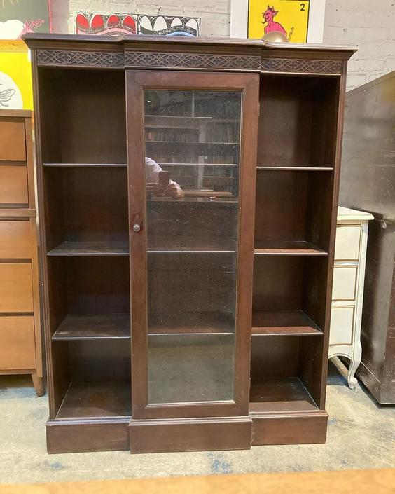 """Glass front bookcase. 38"""" wide 12"""" deep 52"""" tall."""