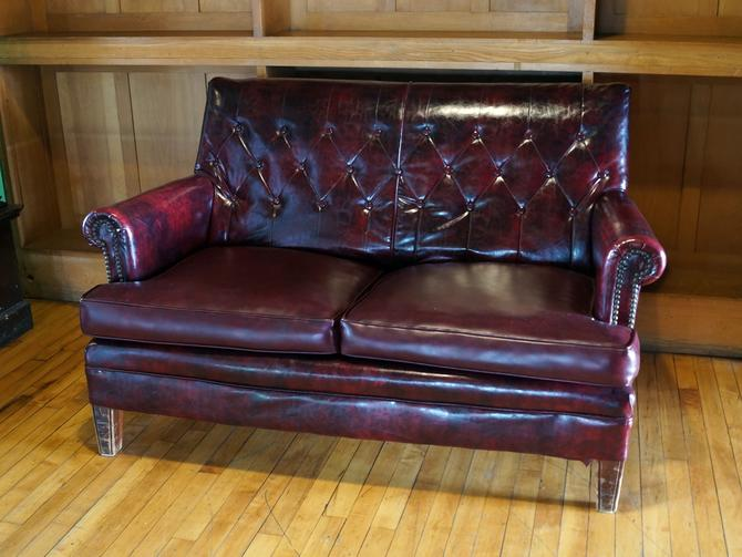 Dark Red Vinyl Loveseat w Button Back
