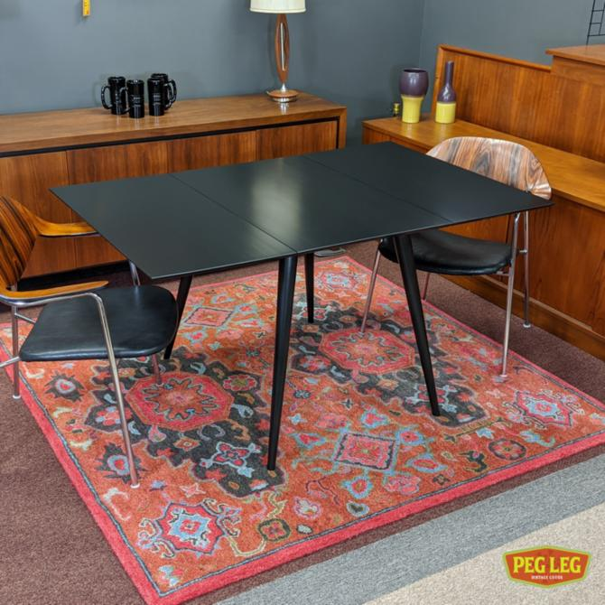 Mid-Century Modern ebonized drop-leaf dining table from the 'Planner' group by Paul McCobb