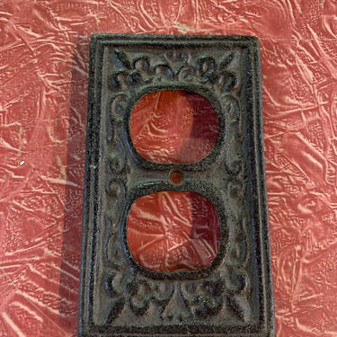 Vintage cast iron electrical faceplate