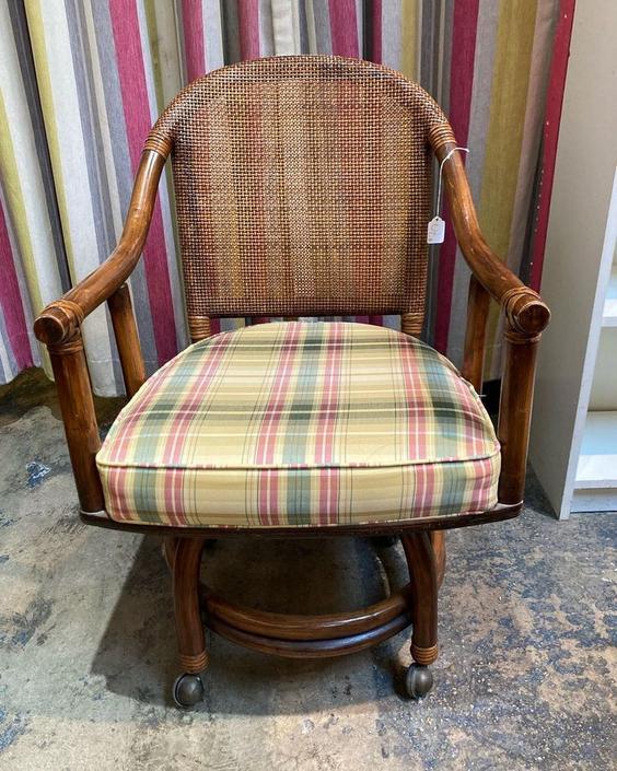 "Rattan chair on wheels. 22"" x 21"" x 34"" Seat height 18"