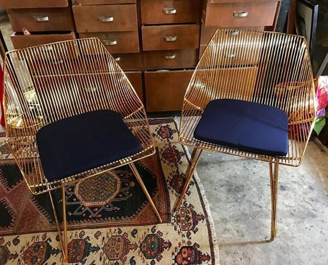"""""""Bunny Lounge Chairs"""" by Bend. Navy Sunbrella seat pads included. $600 for the pair."""