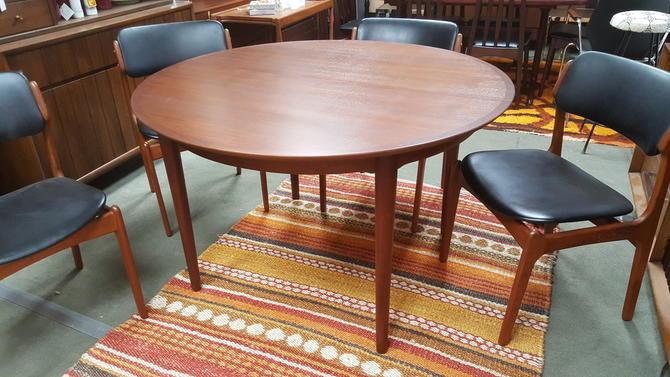 Danish Modern round teak dining table with 2 large extensions by