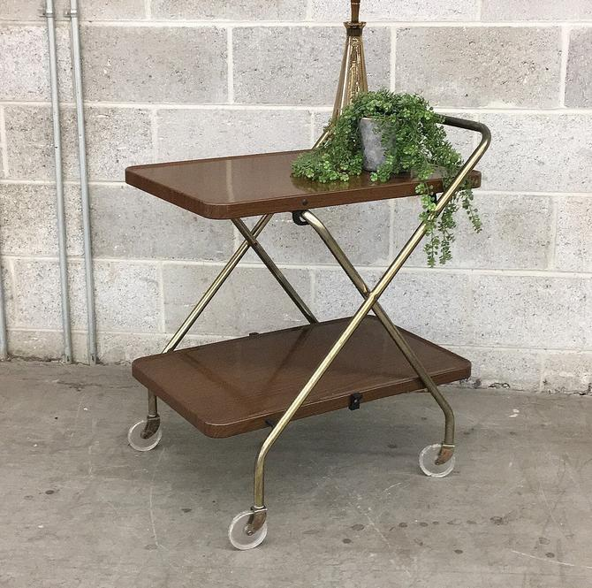 Vintage Rolling Bar Cart Retro 1960s Mid Century Modern + 2 Tier + Gold Metal Frame + Collapsible + Wood Grain + Metal Tray Shelves by RetrospectVintage215