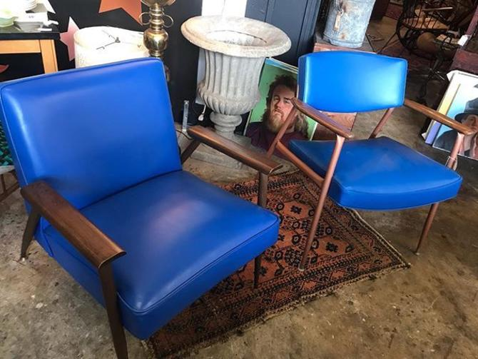 "Mod ""Classic Blue"" chairs, upholstered in blue vinyl. Both manufactured by Viko Baumitter."