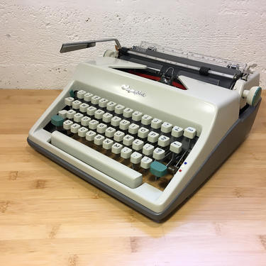 1966 Olympia SM8 Portable Typewriter with Case, New Red/Black Ribbon, Cleaning Kit, Owner's Manual by Deco2Go