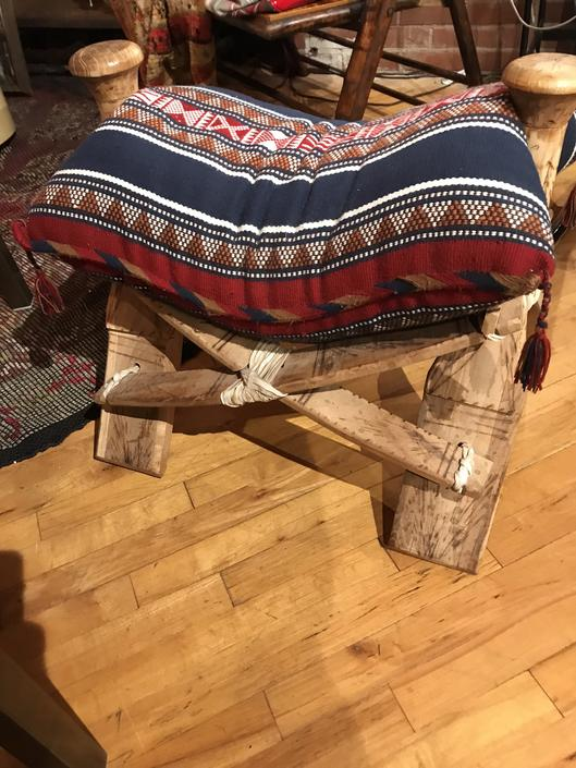Pair of Camel saddles with pillows.
