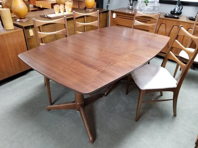 Mid Century Modern Walnut Boat Shaped Dining Table With A Double Pedestal Base