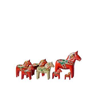 Set of seven Dala horses by Nils Olsson by PeachModern