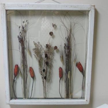 SOLD - Old farm window now a wall art.  Decorated with dried flowers.  This window will have a lovely view no matter where you hang it.
