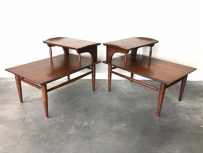 pair of vintage mid century modern tiered end tables.