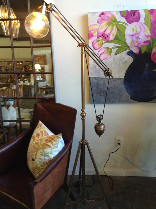 Brass tripod weighted floor lamp