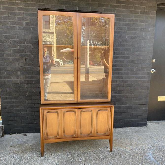 "Mid Century two-piece glass front hutch. 38"" W x 72"" H x 17"" D"
