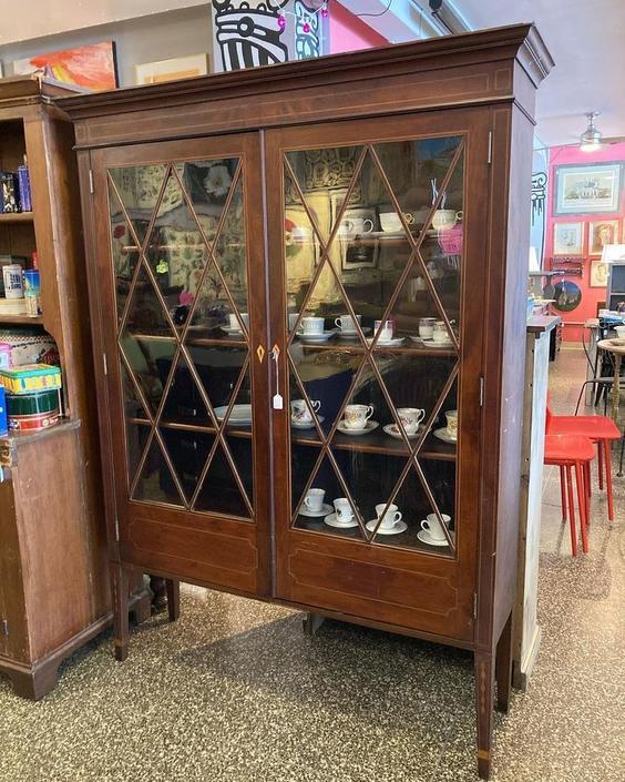 "Glass front mahogany with satin wood inlay. Fabulous satin wood inlay. 58"" x 15.5"" x 77"""