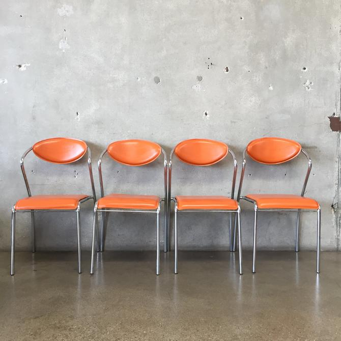 Set of Four Mid Century Orange Leather & Chrome Dining Chairs