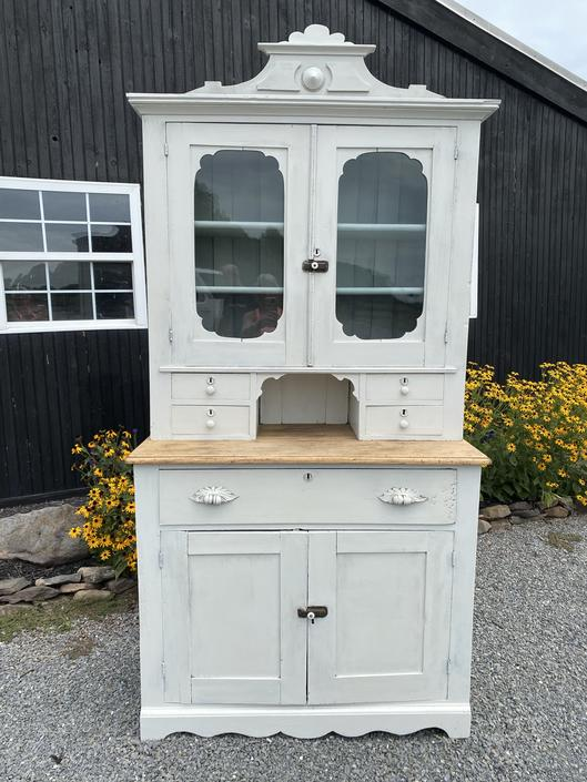 Carved Stepback Cupboard