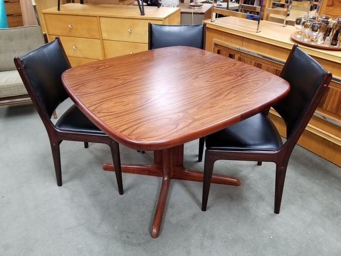 "Danish Modern small scale rosewood dining table with two 20""leaves"