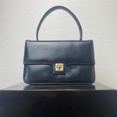 vintage black leather handbag by miragevintageseattle